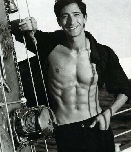 Adrian Brody with a six pack